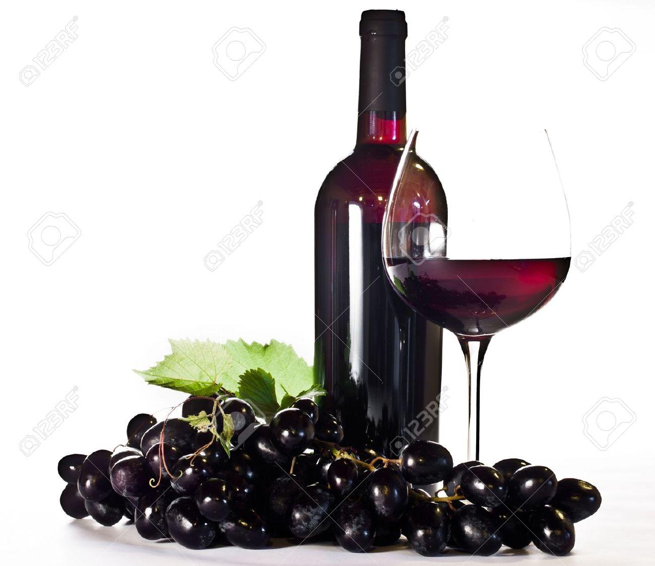 14678992 Botella De Vino Tinto El Cristal Y Las Uvas Negras Foto De Archivo