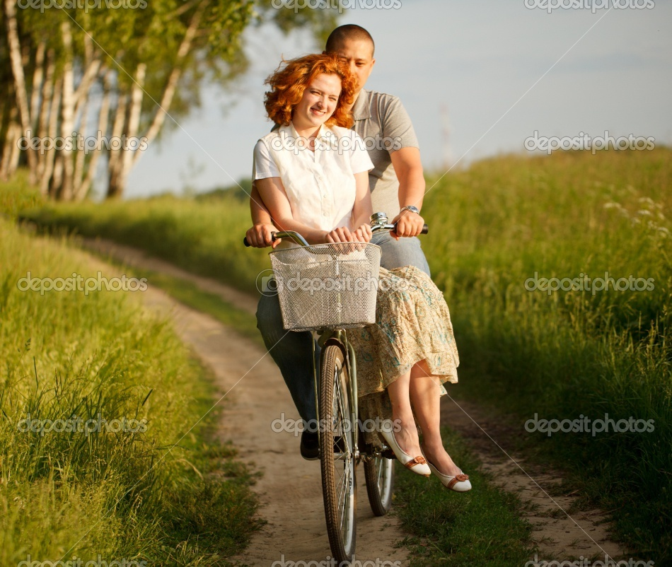 Depositphotos 6128612 Happy Young Couple Riding On A Bicycle