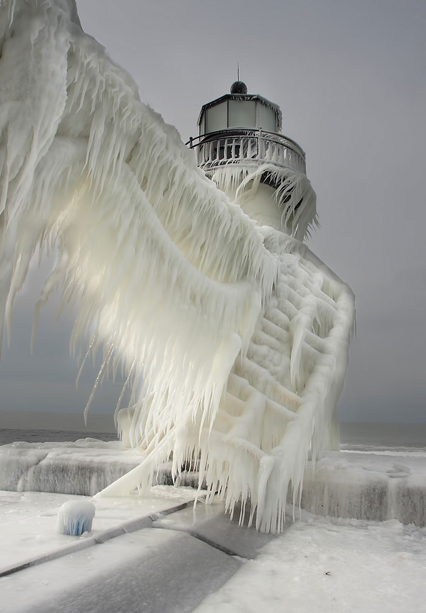 Frozen Lighthouses On Lake Michigan Shore