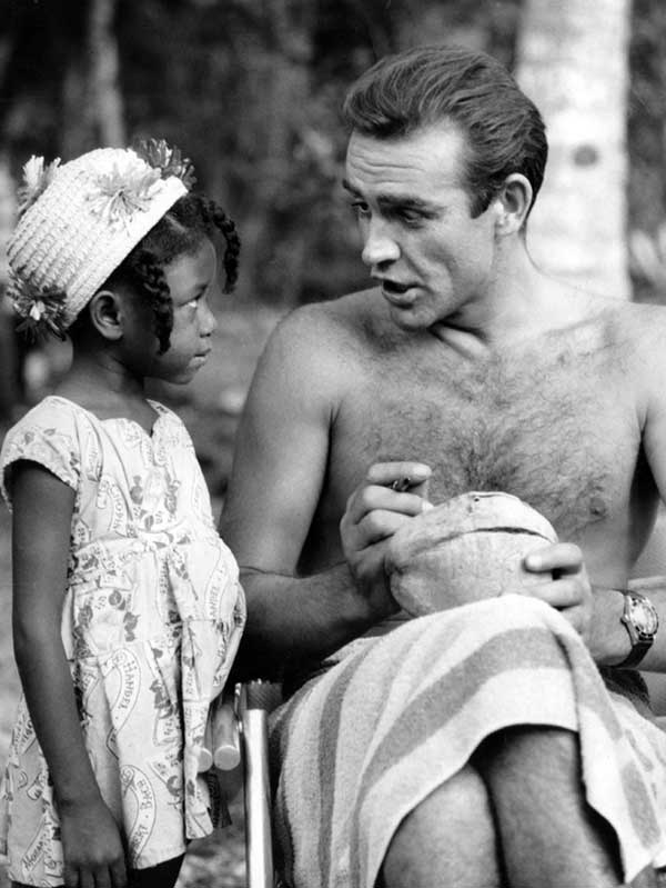 Sean Connery Signing A Coconut For A Little Jamaican Fan On The Set Of Dr No 1962