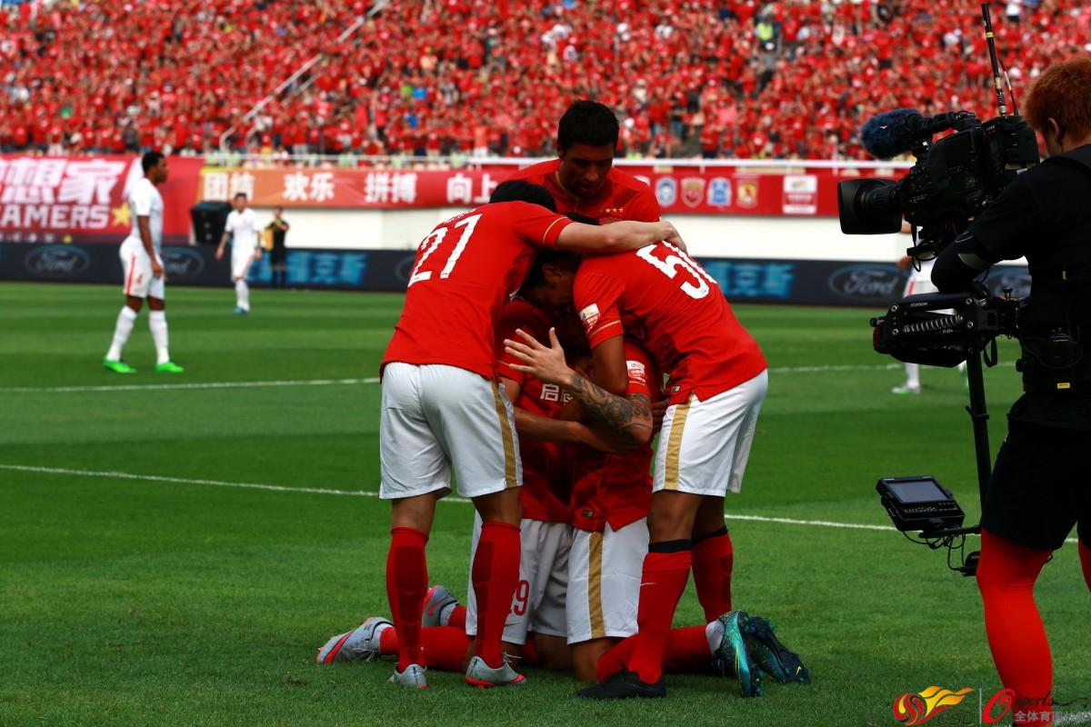 Players Of Evergrande Club Celebrate Their Goal During A Chinese Super League Game Against Luneng In October 1200x800